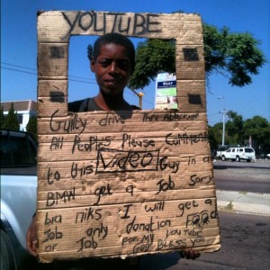 A South African beggar using YouTube as a gimmick